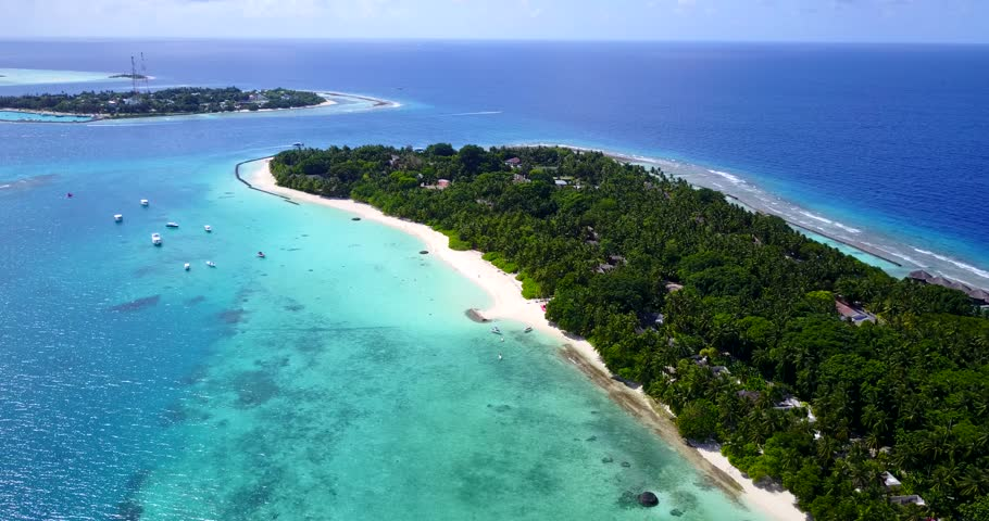 v11405 maldives white sand beach tropical islands with drone aerial flying birds eye view with aqua blue sea water and sunny sky