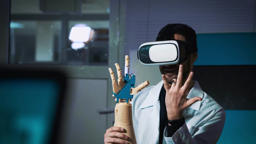 Cybernetic system today. Game industry and motion tracking in cyberspace. Man with innovative spectacles creates movement for mechanical plastic arm. Printing on the 3D printer. Sci Fi and prosthetics