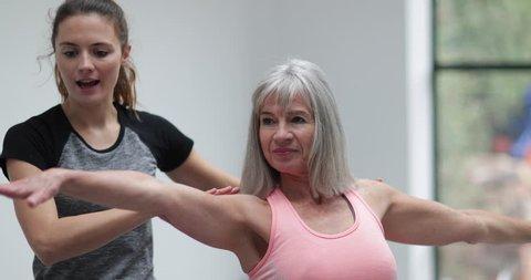 Senior Woman learning yoga
