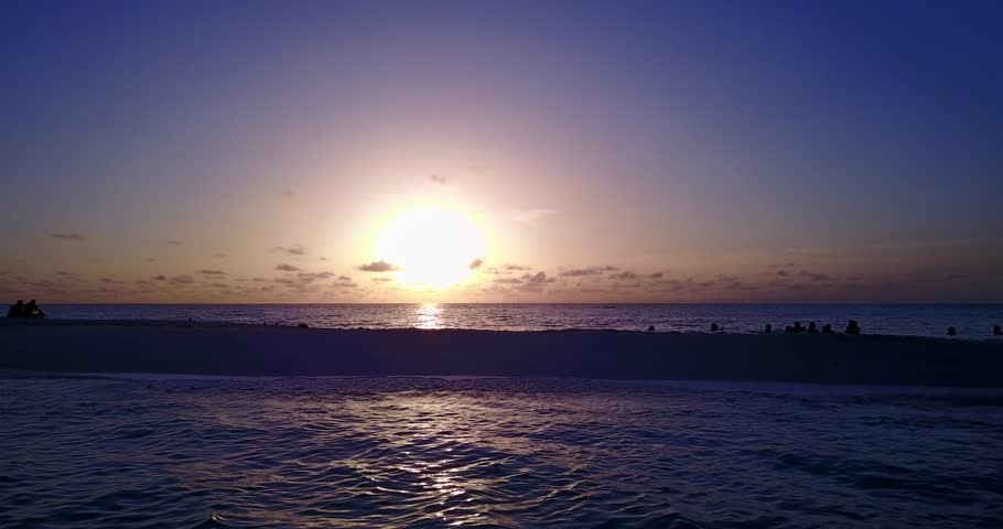 V12751 sunset sunrise group of young beautiful girls on beach with drone aerial flying view of evening morning clear sea water and sky | Shutterstock HD Video #32326828