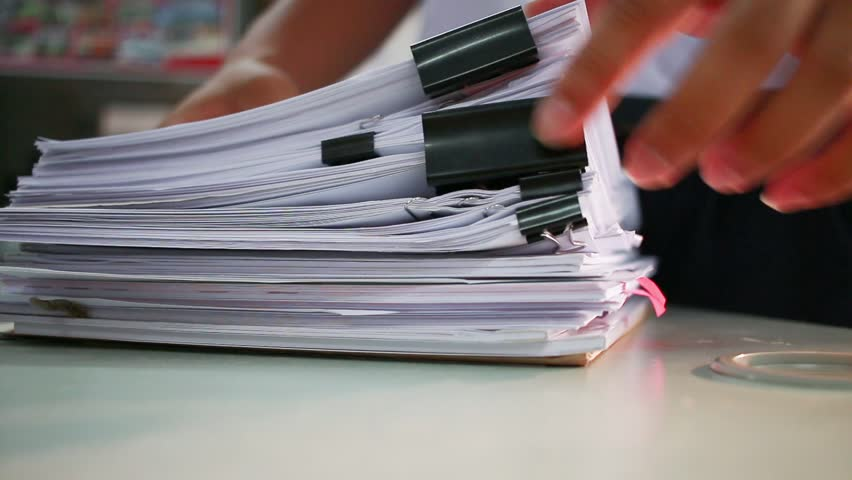 Businessman searching documents files or information in Stack of papers folder on work in office, Business report paper or piles of unfinished document achieves with clips on offices, Business concept | Shutterstock HD Video #32338408