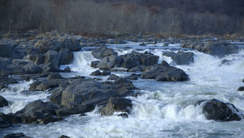 Huge boulders create whitewater rapids in a wilderness river.