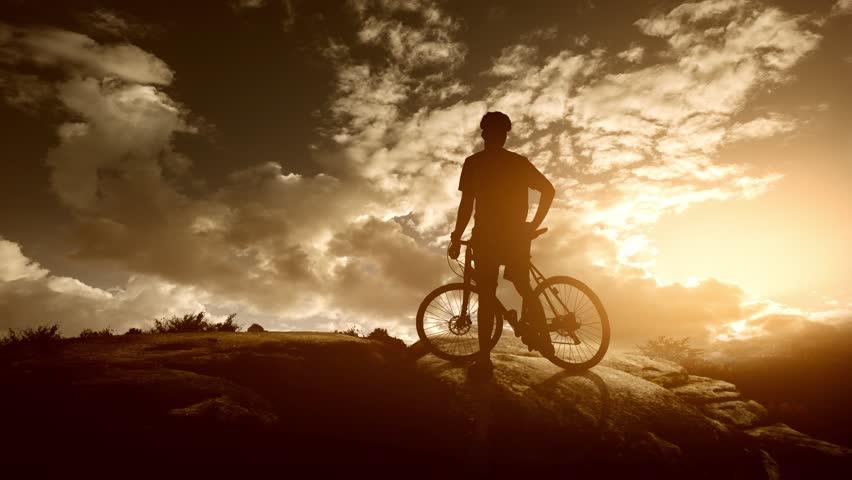 Mountain biker enjoys sunset   Shutterstock HD Video #32353768