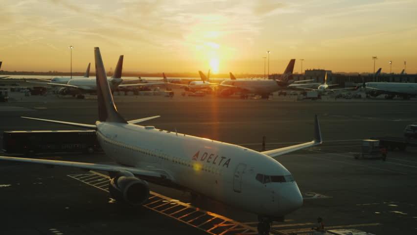New-york, USA, September, 2017: Sunset at the international JFK airport. Airline Delta on the fist plan