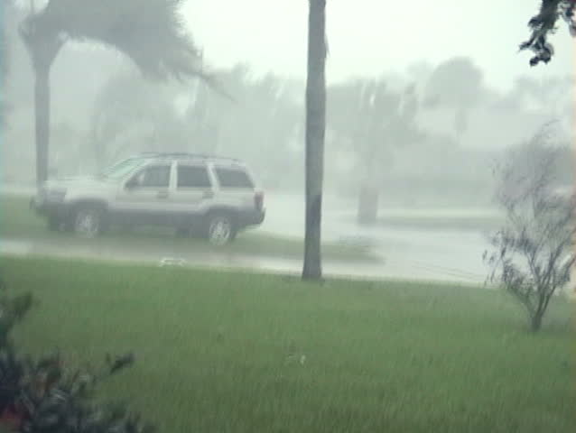 100 MPH + hurricane winds and rain blowing DEBRIS!