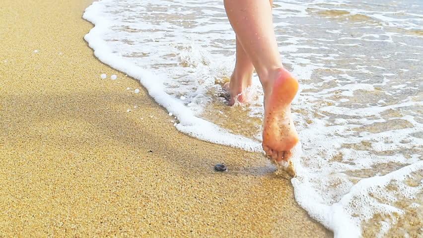 Beautiful woman legs, runn along the sand beach. Walking in the water. | Shutterstock HD Video #32372008