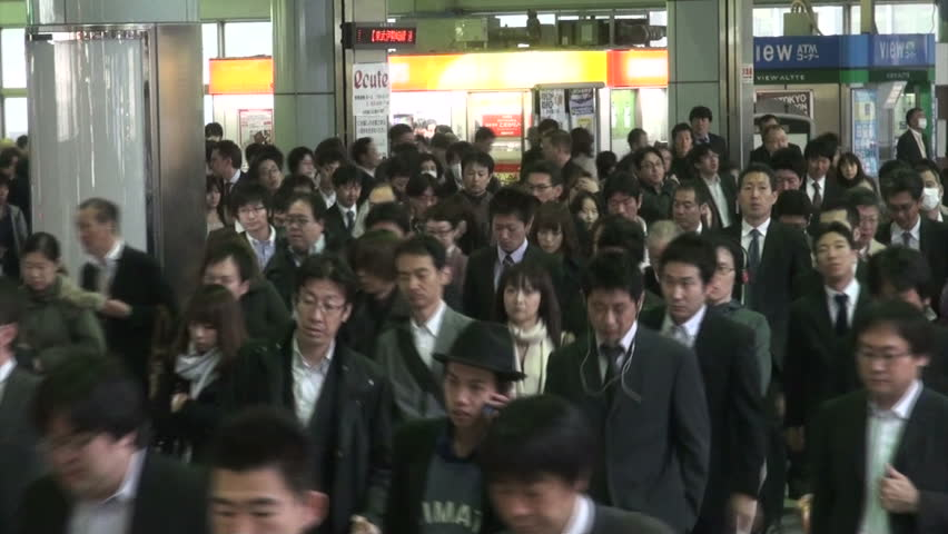 TOKYO, JAPAN - 6 NOVEMBER 2012: Commuters going to work make their way through the busy Shinagawa train station during rush hour in Tokyo, Japan
