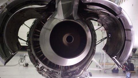 Engine of the airplane under heavy maintenance. Aircraft maintenance, dismantled plane engine. Chassis of the airplane under heavy maintenance