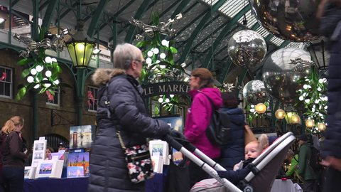 LONDON, UK - circa 2016: Christmas decorations in Covent Garden market,View of Apple Market in Covent Garden. The Apple Market is sells arts and crafts dedicated to antiques and collectables items.