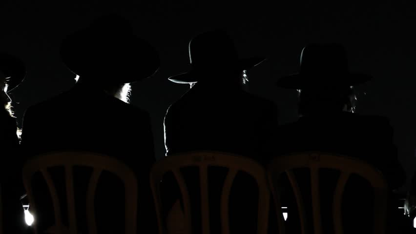 Silhouette of Rabbis during lecture of Rabbi Erenberg outside military Prison 6, protesting after their friends were arrested for failing to report to military service, Atlit Israel, OCT 25, 2017