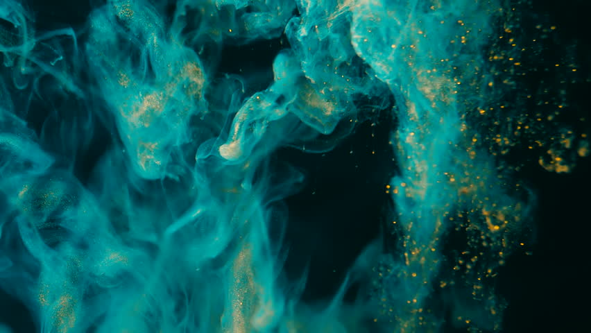 Ink in water. Turquoise with gold glitter paint reacting in water creating abstract cloud formations.Can be used as transitions,added to modern projects,art backgrounds, anything with creative twist.