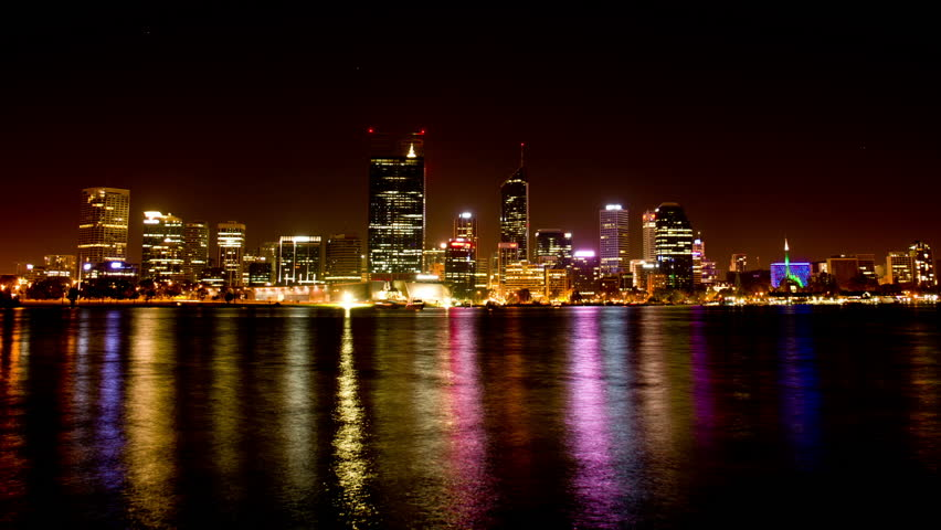 Time lapse of Perth City (Australia) with the beautiful lights of the city reflecting on the water of the Swan River.