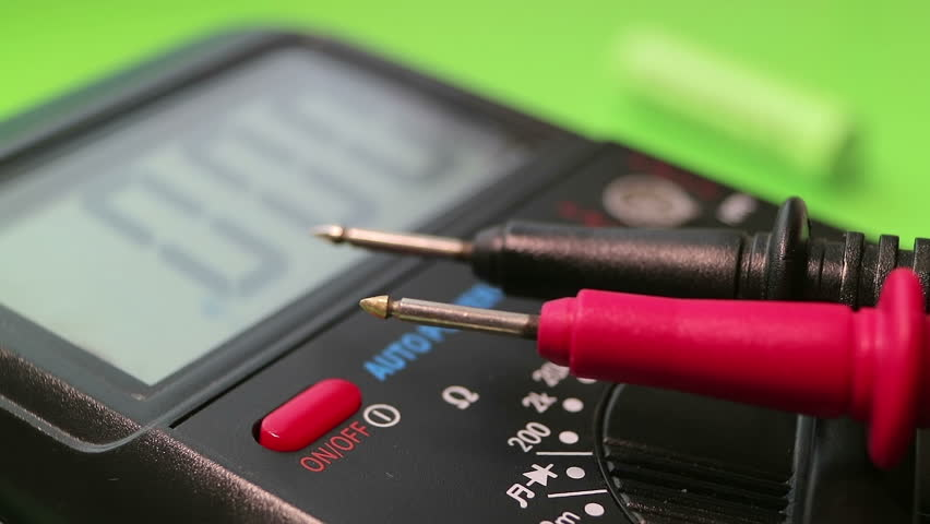 Multimeter close-up on a green background. Mode dial. Power button. The man is measuring. Full HD video. | Shutterstock HD Video #32485108