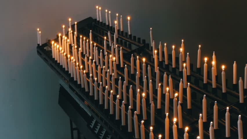 Many Candles Are Lit in the Christian Church of Orthodoxy. Many burning candles in christian church. Altar and religion. The Architecture Christian Orthodox Church Interior. Christian church aisle.