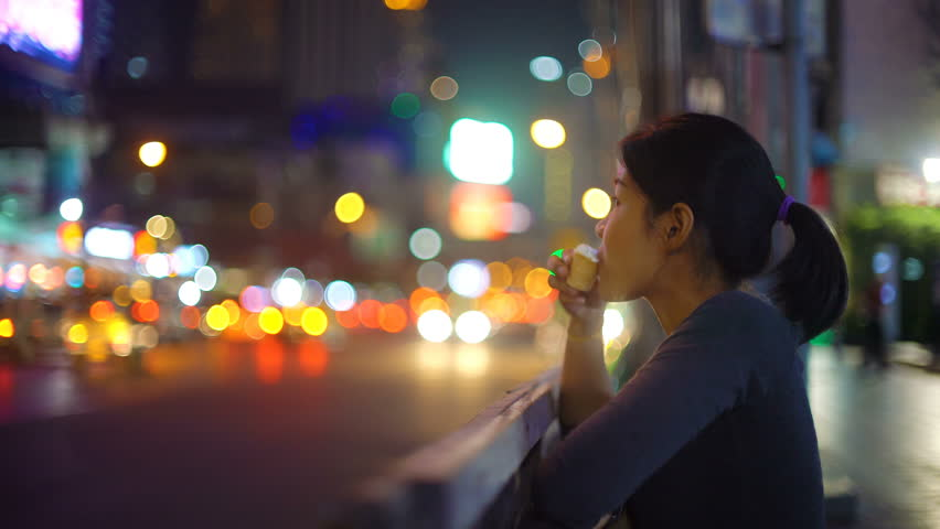 Young Asian Woman eating ice cream in night Bangkok 4k UHD (3840x2160) | Shutterstock HD Video #32532688