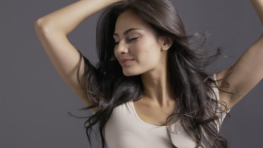 Close up slow motion shot of beautiful model tossing hair / Cedar Hills, Utah, United States