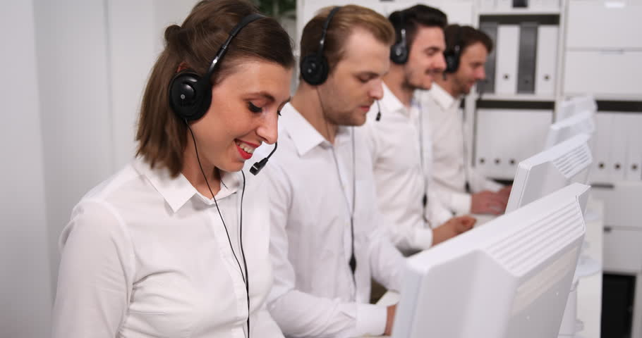 Colleagues Team Work Helpdesk Consultant Group Talking Phone Call Center Office