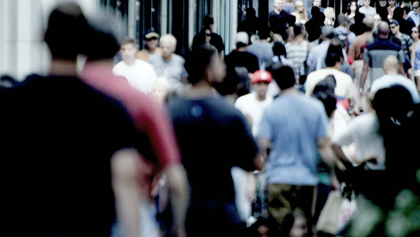 America - August 22, 2012: City population walking on busy sidewalks