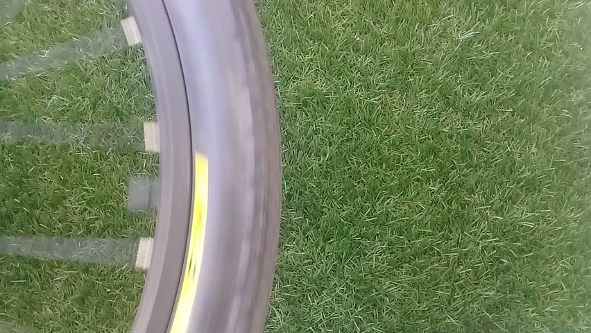 Video for rotating bicycle tire with green grass as a background | Shutterstock HD Video #32580040