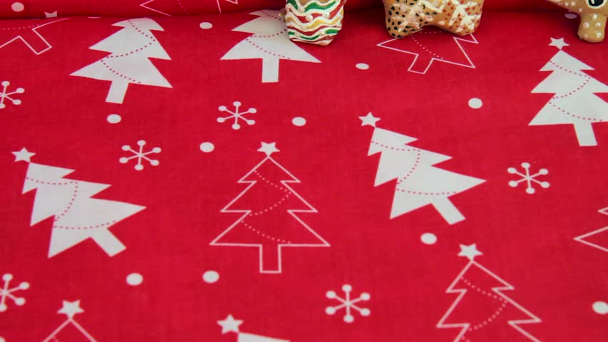 Christmas decorations and toys on red background with ginger cookies | Shutterstock HD Video #32593528