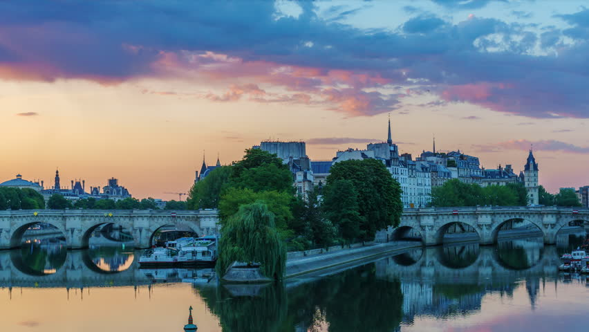 Sunrise over la Cite in Paris, France, with Pont Neuf and Seine river. Colourful travel background. Romantic cityscape. 4K night-day timelapse.