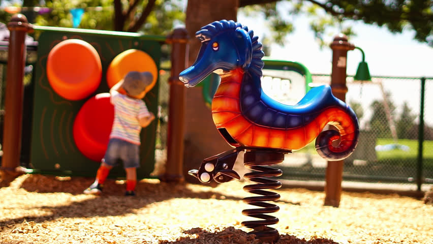 Kids park play area sea horse ride - cinemagraph