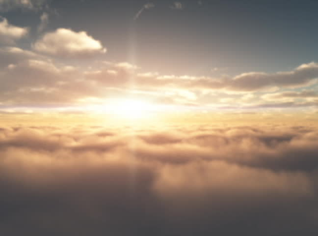 Aerial Sunrise.  Sunrise as seen from the air between two different cloud layers.  Sun in front of camera.