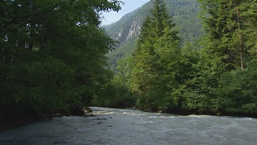 stream river in valley. The Lütschine is a river in the Bernese Oberland, Switzerland