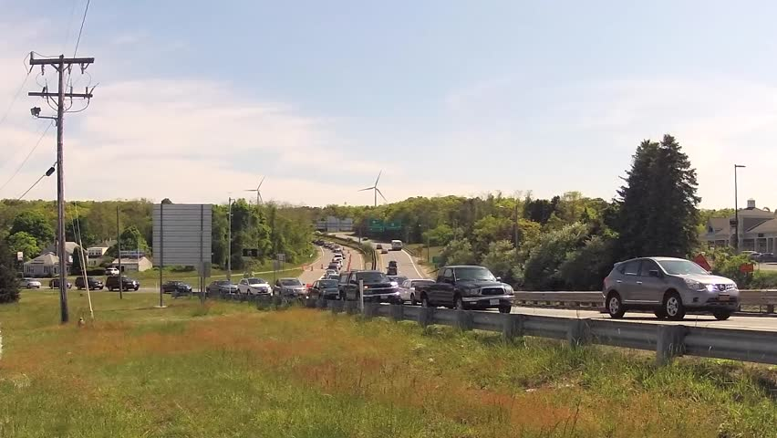 Cape Cod bridge traffic time-lapse during busy holiday summer weekend with lots of tourists - HD stock video clip