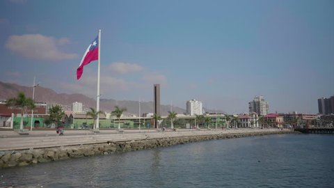 Large Chilean flag flies in slow motion in Antofagasta, Chile