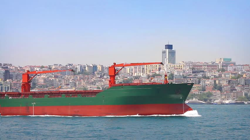A bulk carrier ship sailing in front of Istanbul City. A 115 mt long, 17 mt