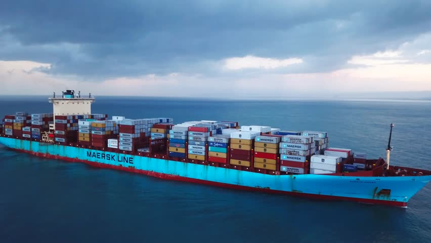 Mediterranean sea - November 2, 2017: Aerial footage of a large Maersk container ship sailing the Mediterranean sea in stormy weather. #32703508