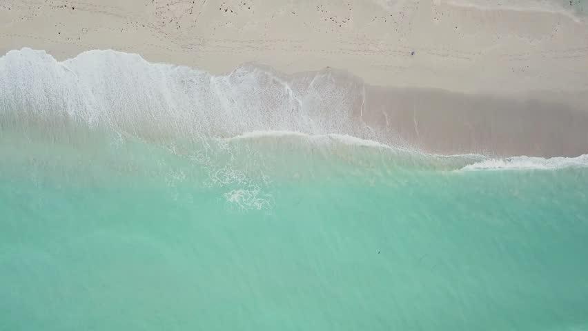 Aerial view of greenish-blue wavy ocean near clean sandy coastline on day time,sunny isles beach,miami   Shutterstock HD Video #32722018