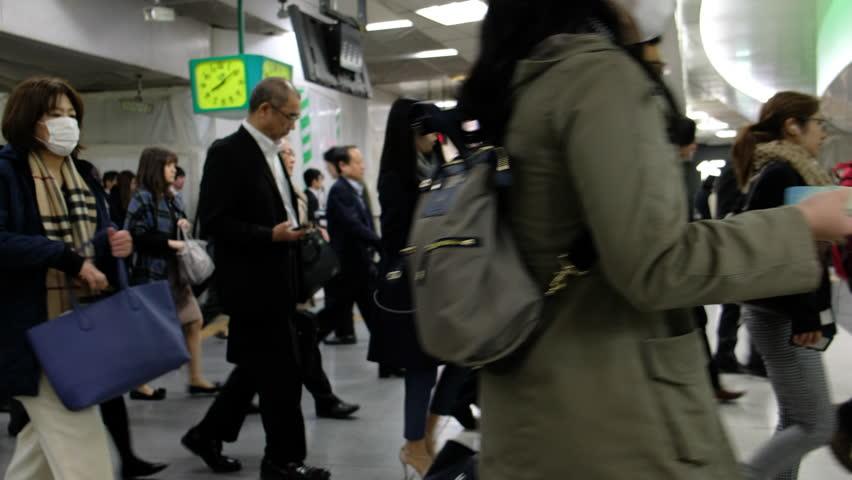 TOKYO, JAPAN - NOVEMBER 10TH 2017. Commuters rushing through ticket gates in Shinjuku Station train platform. Panning shot. | Shutterstock HD Video #32762266