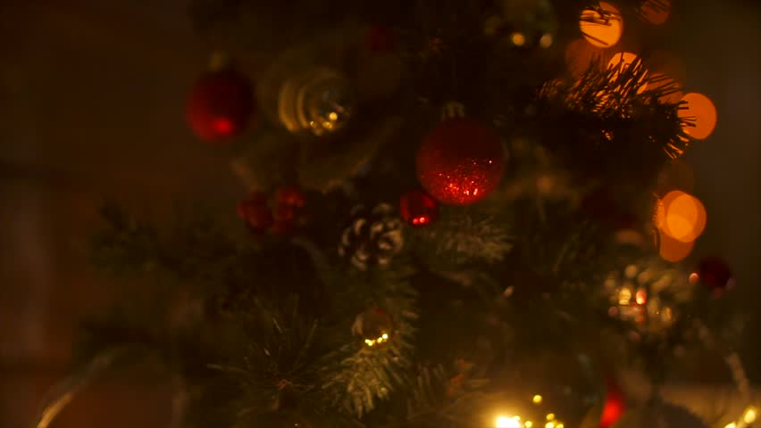 New Year 2018. New Year, new year, light background. New Year mood, Christmas tree, Christmas tree toys. Lights, bokeh. Room, fireplace, Christmas tree, log, Yellow light. slow motion, red lights