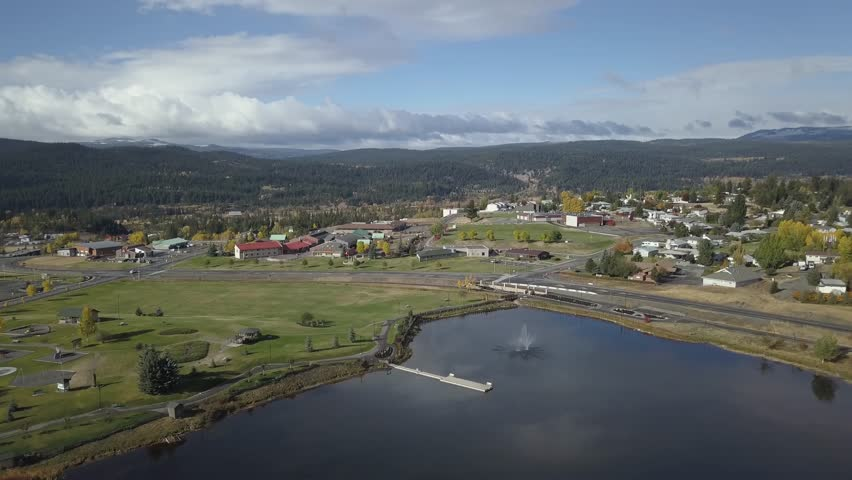 Aerial 4k drone footage of a small beautiful town, Logan Lake, during a vibrant sunny Autumn day. Taken in the interior of British Columbia, Canada.