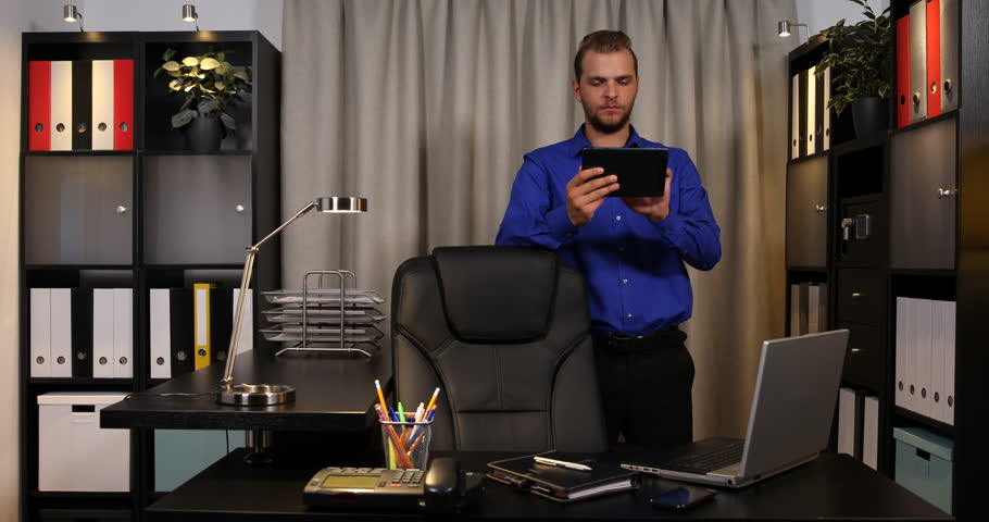 Banker Business Man Browsing Digital Tablet and Pose Serious Look Camera Office | Shutterstock HD Video #32829358