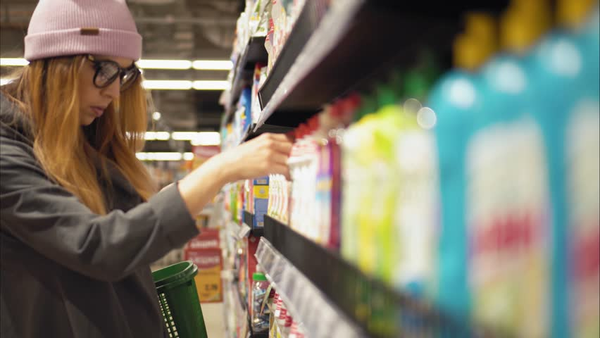A young hipster female chooses dish soap in the store | Shutterstock HD Video #32832598