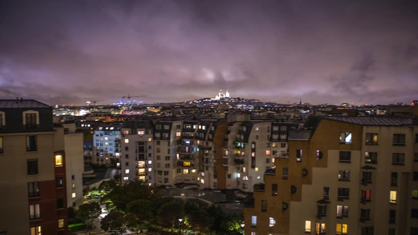 Night top view of the Montmartre and roofs of autumn rainy Paris. 4K Time Lapse Footage. | Shutterstock HD Video #32833183