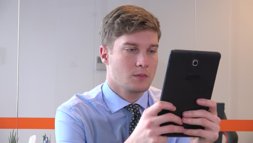 Close up handsome young businessman indoors workplace working tablet computer 4K | Shutterstock HD Video #32837068