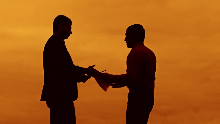 Businessman discussion sunset silhouette sunlight standing clipboard concept. two businessman men shake hands meeting are in talks looking at outdoors slow motion video | Shutterstock HD Video #32845261