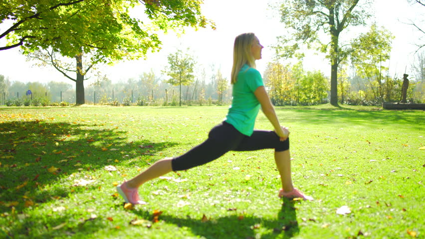 Fitness woman doing sports exercises outdoors on autumn park, Female is training in sunny day light in the fall trees background | Shutterstock HD Video #32852728