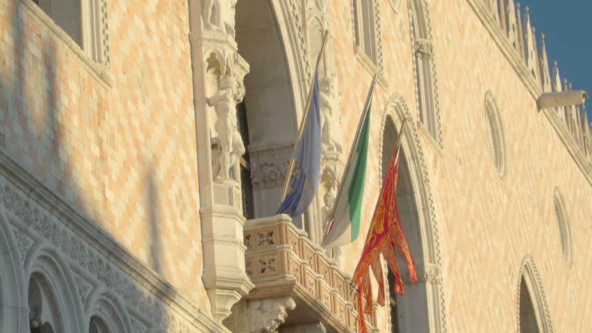 Three flag on their poles on the window veranda of the palace of the Palace of Ducale in Venice Italy | Shutterstock HD Video #32862268