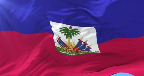 Flag of Haiti waving at wind with blue sky, loop