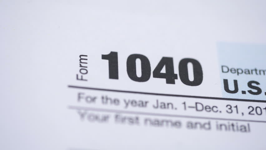 Tax form 1040. Dolly shot. Extrem close-up view.  | Shutterstock HD Video #32924638