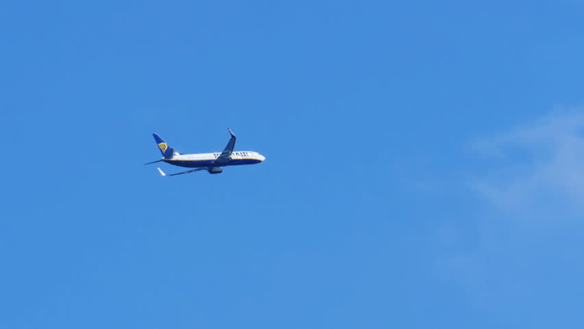 BARCELONA, SPAIN, SEPTEMBER 21 2017: The passenger airplane is flying far in the blue sky. Beautiful background of a flying airplane. Airplane flying deep blue sky. Commercial jet flying away far into