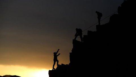 team success and unity spirit climbing mountain