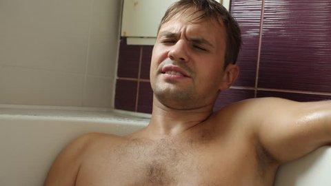 man taking a bath. 4k, slow motion