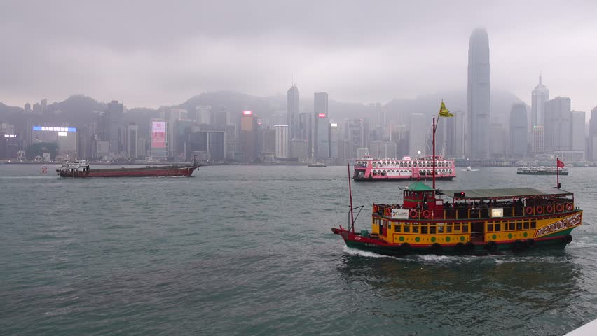 Hong Kong - Oct 30, 2017. Tourist boat on Victoria Bay in Hong Kong, China. Hong Kong is one of the most popular destinations in the world with 40 millions visitors per year. | Shutterstock HD Video #32964028