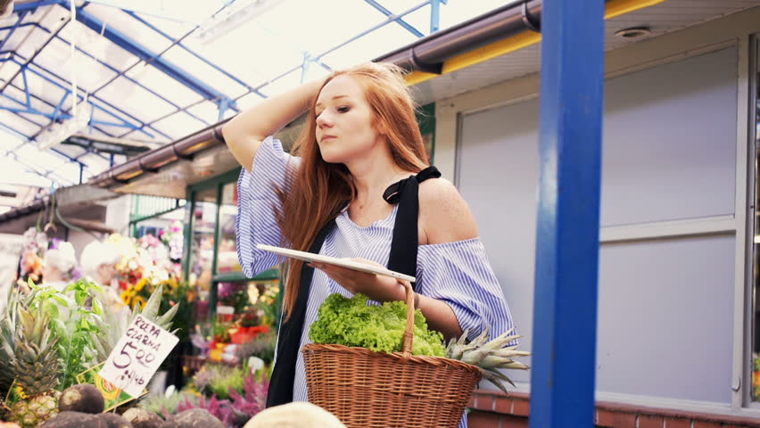 Beautiful woman with tablet checking vegetables at local farmers market  | Shutterstock HD Video #32969338